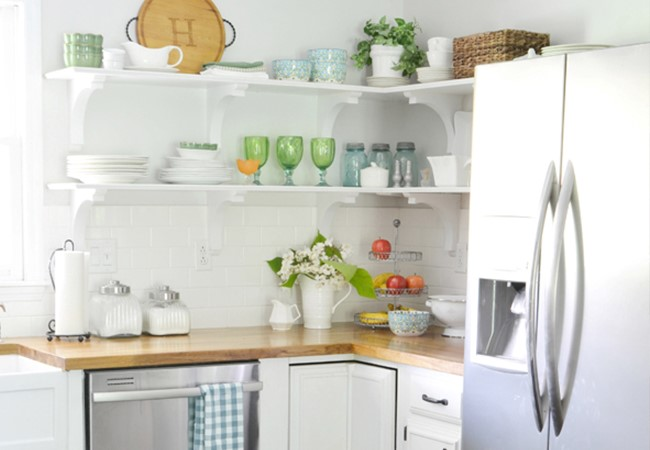 Open kitchen shelving in a white kitchen designed by blogger Beneath My Heart