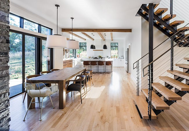 Scandinavian dining table leading into kitchen