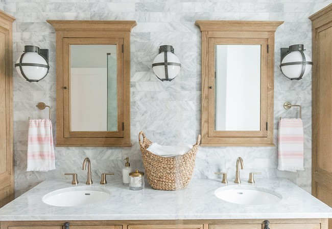 gray and white tiled bathroom with double vanity designed by blogger The Leslie Style