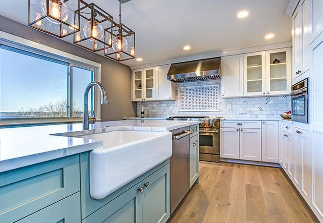 two toned cabinets mint and white farmhouse sink
