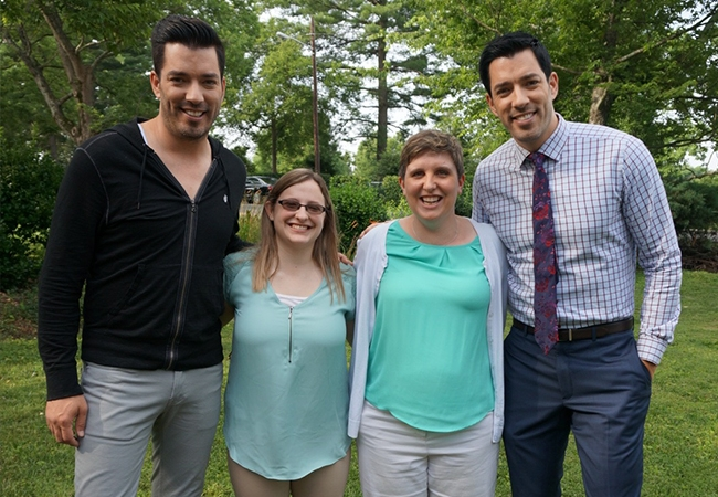 Property Brothers Drew and Jonathan Scott pose with Pella representatives on their show Buying and Selling