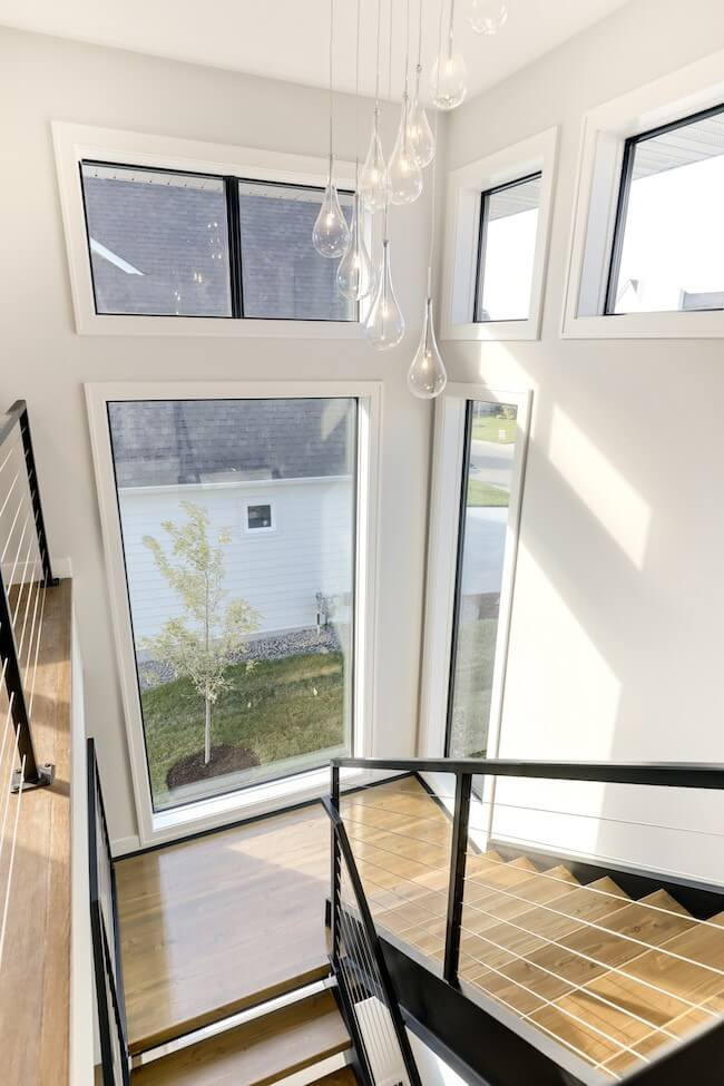 Kootenia Home stairwell two large fixed and four smaller fixed windows