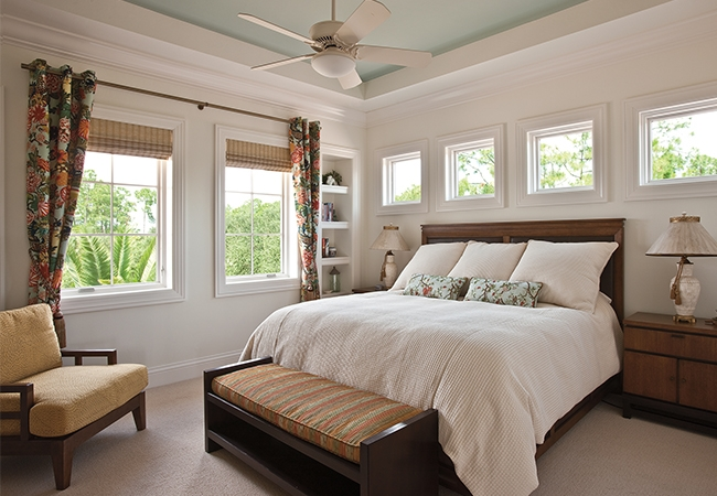a beautiful master bedroom with cream colored walls and a cream comforter on the bed