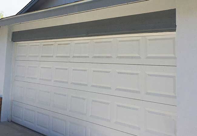 The old garage door on the house with less curb appeal