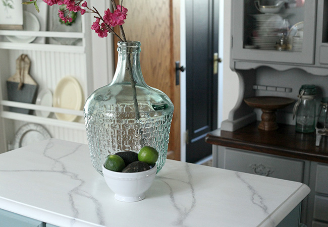 Kitchen with faux marble countertop by Tammy Damore and the blog A House in Bloom