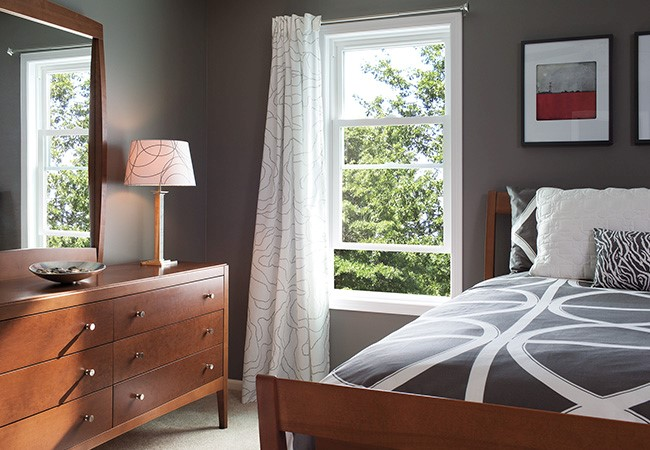 Bedroom with 250 Series Double-hung windows