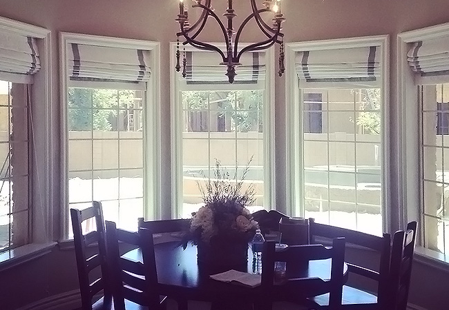 Window treatment styles for casement windows in a dining room