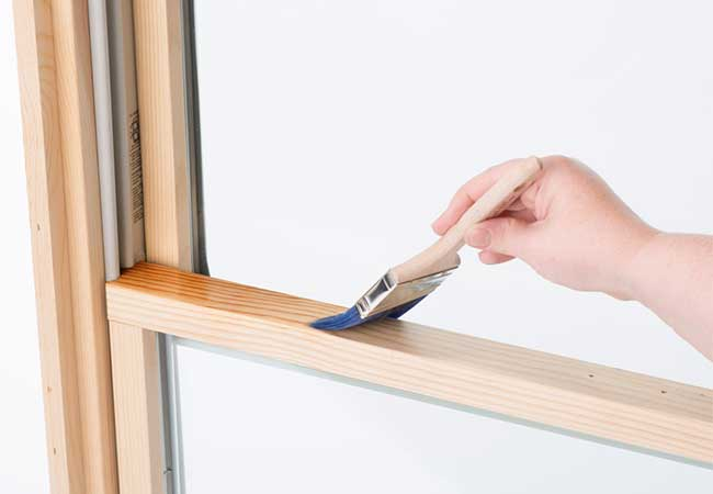 Brushing the window with pre-stain wood conditioner before staining