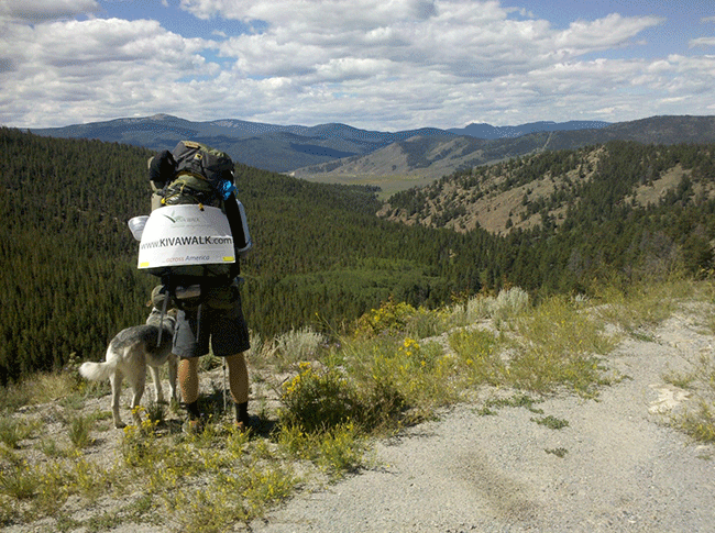 Jonathon and his dog appreciating the mountainous landscape during his 8 1/2 month walk.