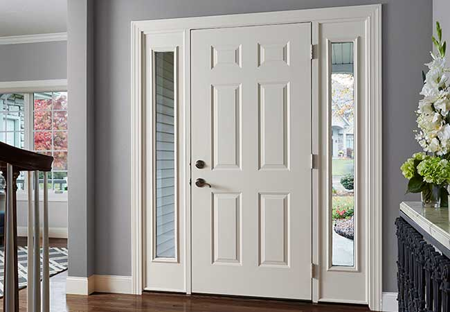 Interior view of a plain white entry door