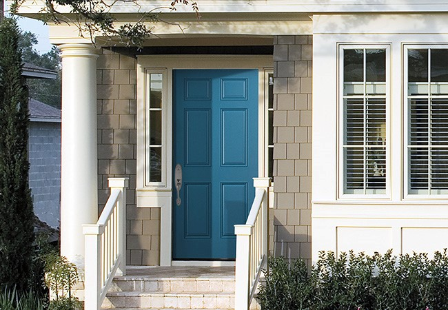 Exterior view of a Pella entry door painted in one of our Vibrancy colors