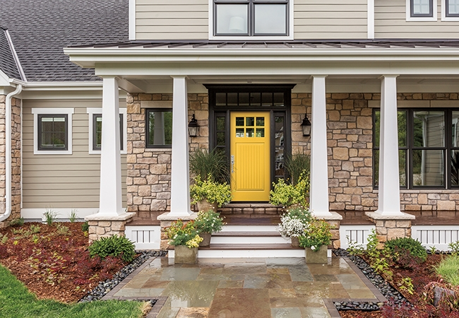 A bright yellow door showcases this home