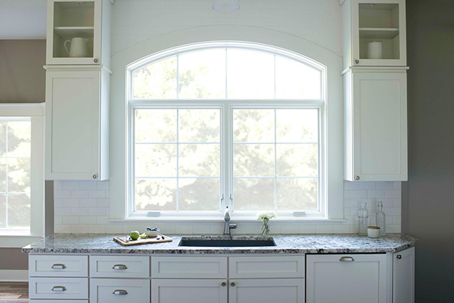 pella lifestyle series window two white casement windows with arch head