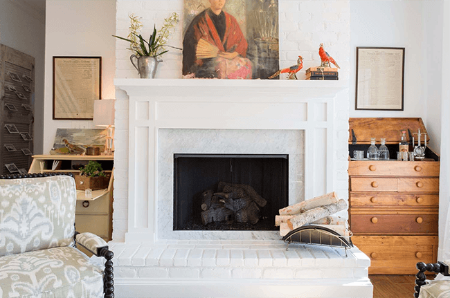 fireplace design ideas traditional white marble fireplace natural wood accents
