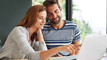 couple evaluating a project quote on their computer