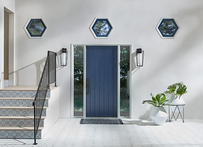 Blue entry door with clear glass sidelights