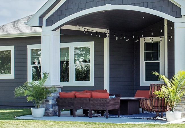 outdoor living spaces colorful furniture and lights