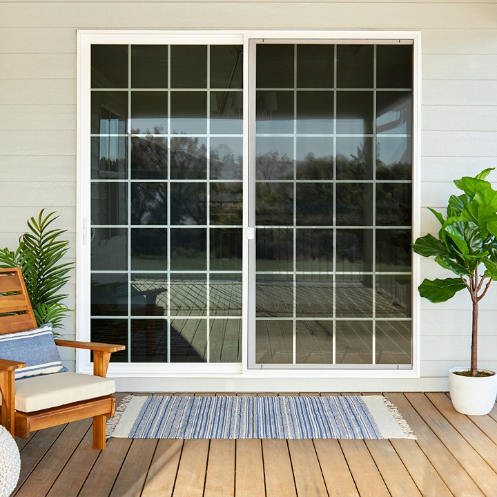 sliding patio door with traditional grilles back deck