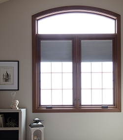 dark wood pella lifestyle series windows with arched transom