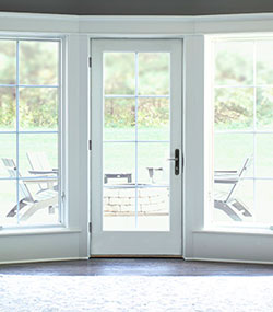 two open lifestyle windows and one door with white trim pella at lowes