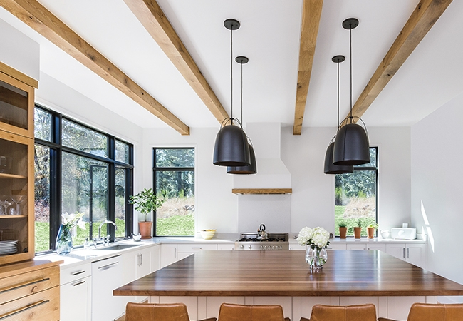 white kitchen with natural wood accends and new interior window colors