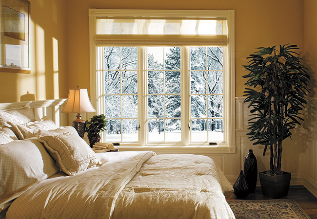 warm golden bedroom thanks to the energy efficient Pella windows