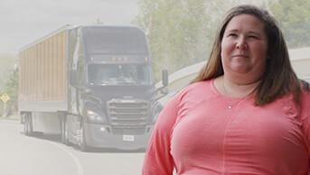 Schneider Van Owner-Operator women truck driver wearing pink long sleeve shirt