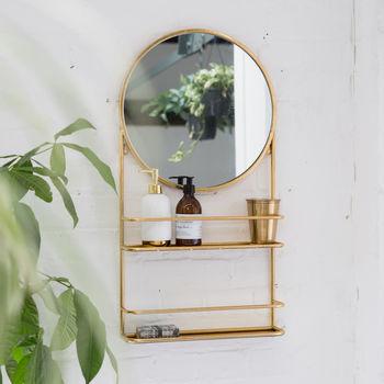 notonthehighstreet.com - gold circular wall mirror with shelfs