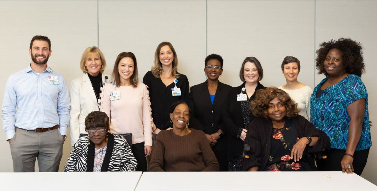 A group of people with community members who benefited from Aging True services joined a luncheon hosted by Baptist Health.