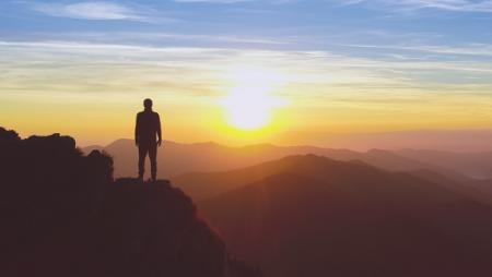 Person gazing at sunrise