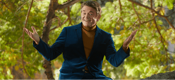 John Michael Higgins singing in a tree