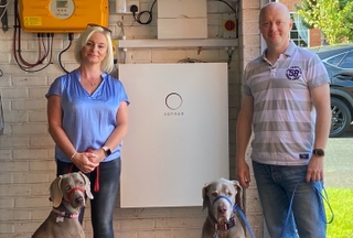 Dawn (left) and Brendan (right) O'Hare, their two dogs Zak and Ellie and their sonnenBatterie which was installed in their garage.