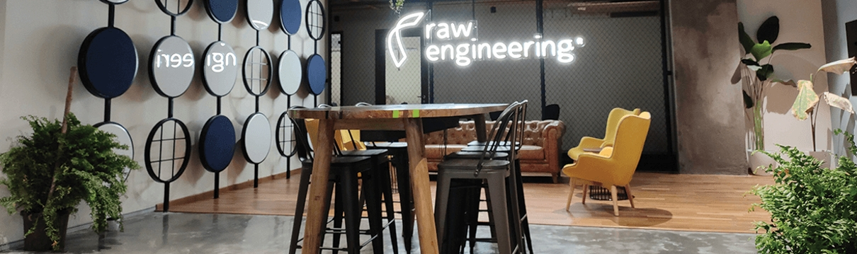 Image of Raw Engineering office with Raw Engineering neon light