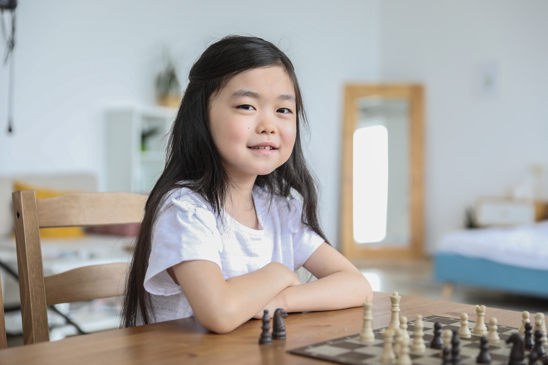 Young_child_memorizing_chess_checkers_techniques_and_tricks.jpg