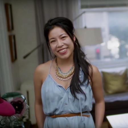 Woman smiling in her bedroom.