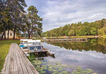 Lake with boat rentals at Holly Lake Resort in Texas.