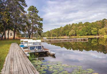 Lake with boat rentals at Holly Lake Resort in Texas.