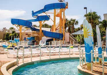 Pool with waterslide at Cape Canaveral Beach Resort.