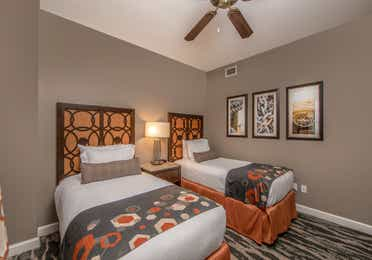 Bedroom with two twin beds in a three-bedroom villa at Sunset Cove Resort in Marco Island, Florida