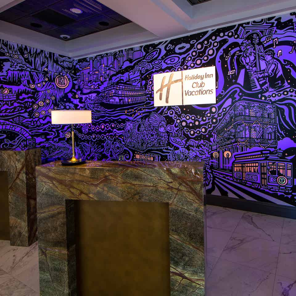 A mural with animated projection mapping in various colors of purple, orange, yellow and magenta featured in the lobby of our resort in New Orleans, Louisiana.