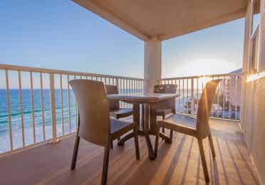 Furnished balcony with table and four chairs and view of ocean at Panama City Beach Resort