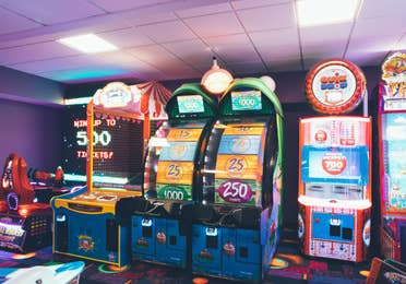 Arcade with Space Invaders, Quik Drop, and other arcade games in West Village at Orange Lake Resort near Orlando, Florida