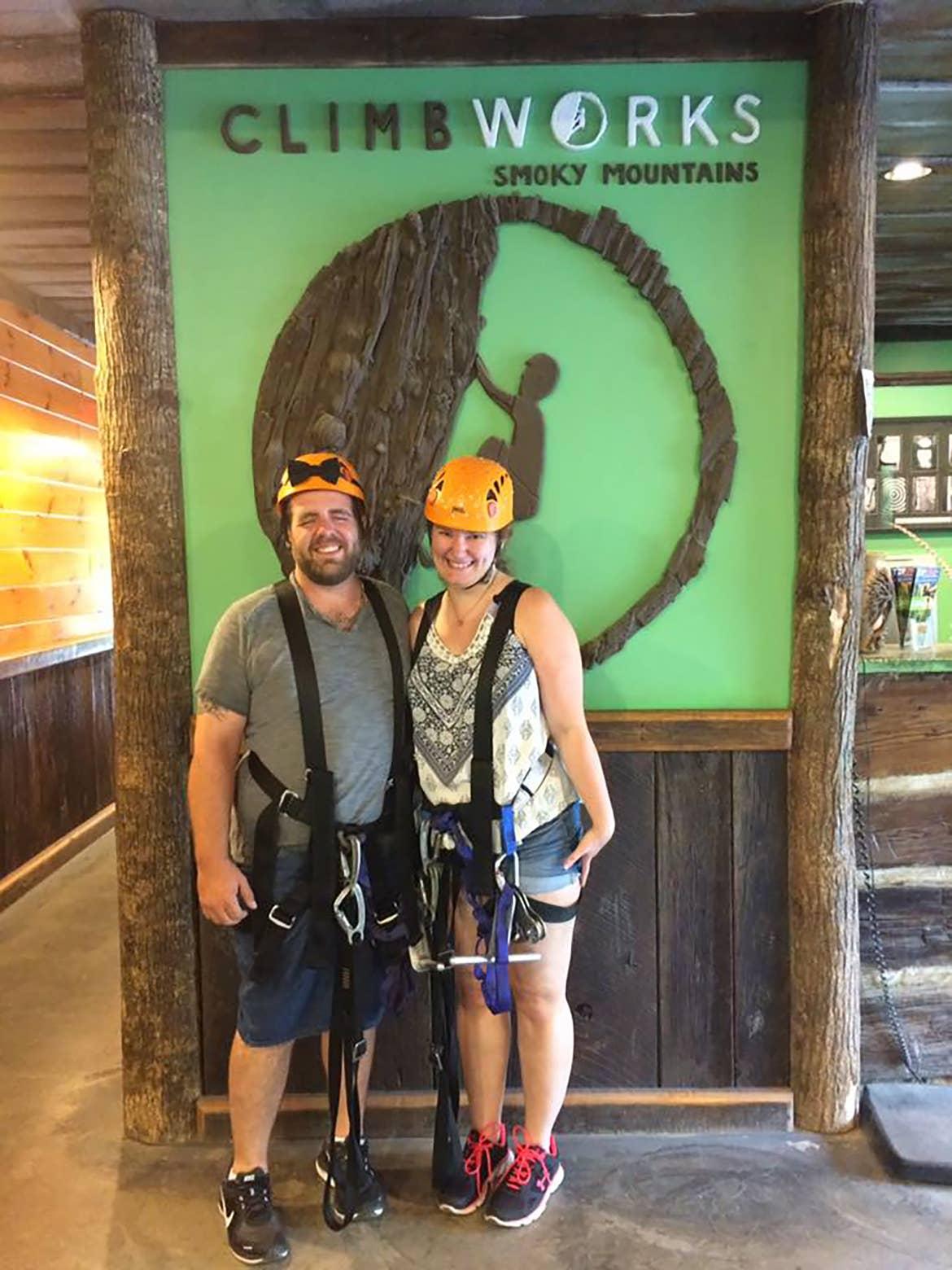 Becca and her husband wearing ziplining gear