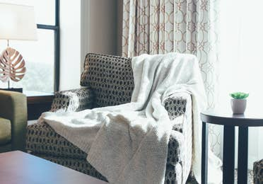 Closeup of comfortable chair with blanket draped over the back in a villa in River Island at Orange Lake Resort near Orlando, Florida
