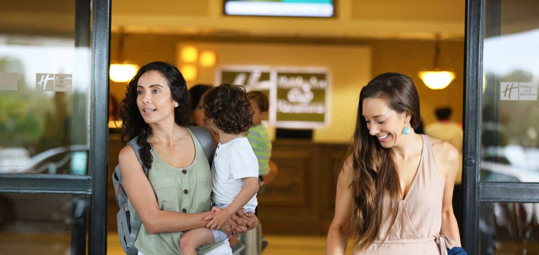 Family leaving check-in to visit their villa at Orange Lake Resort near Orlando, Florida