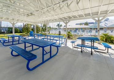 Picnic tables in pavilion at Orlando Breeze Resort in Florida.