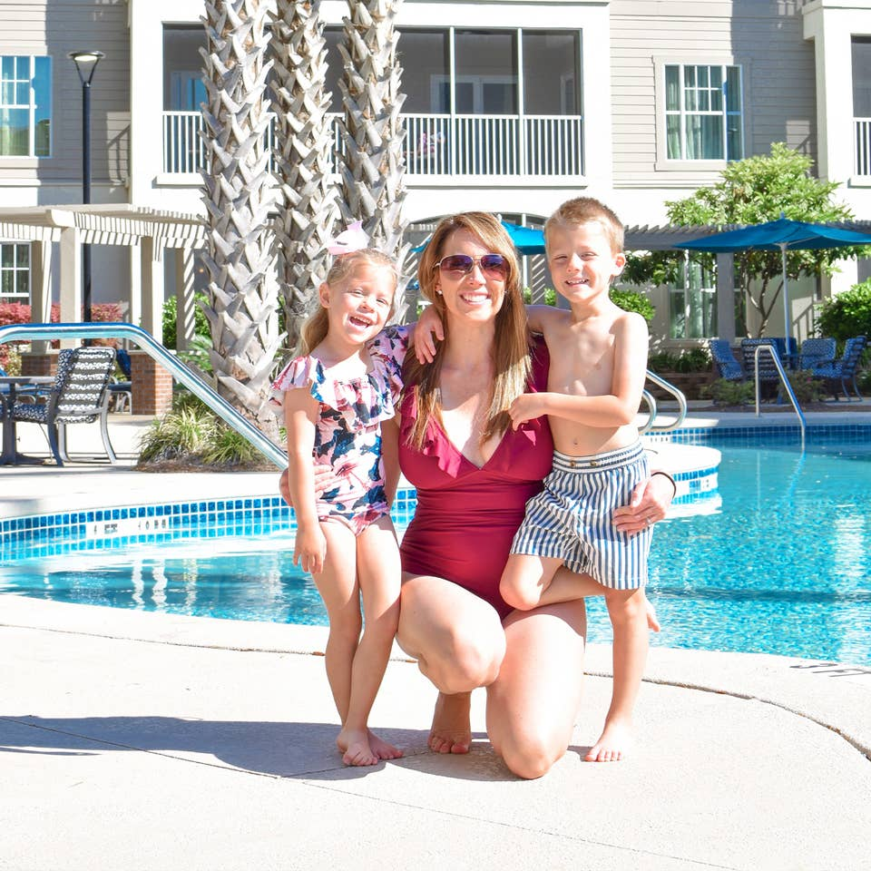 Featured contributor, Brianna Steele (middle), and her two children pose near our pool at South Beach Resort in Myrtle Beach, SC.