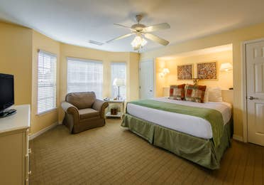 Large bedroom with a king bed in a two-bedroom presidential villa at the Hill Country Resort in Canyon Lake, Texas.