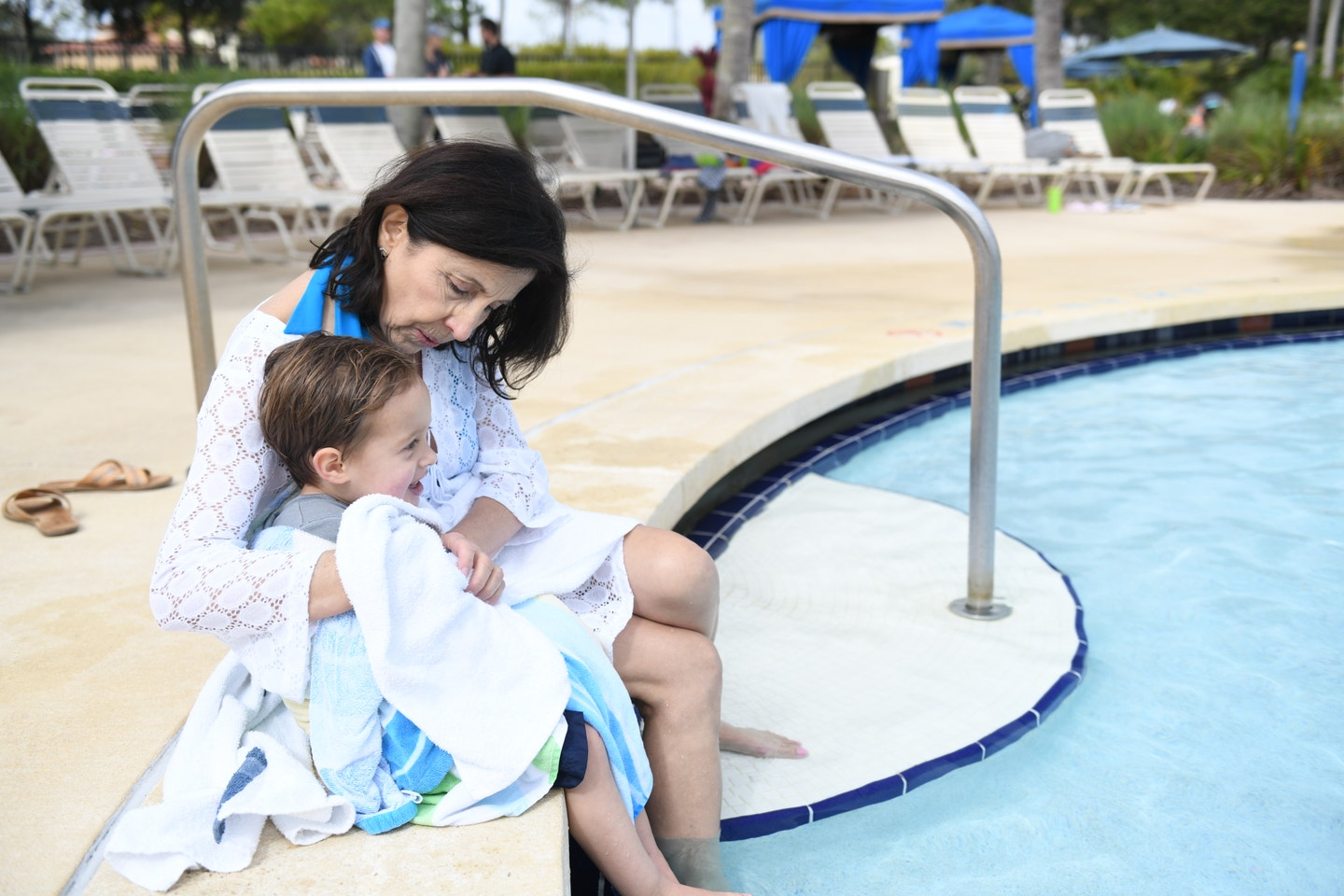 Mother with her child at a resort pool