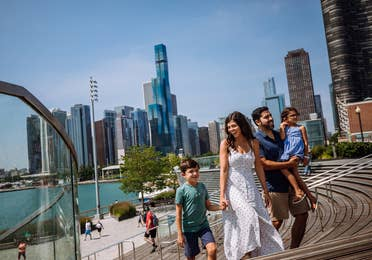Family of four walking around the Navy Pier at Chicago, Illinois